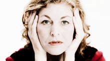 Frazzled Woman With Hands on Face